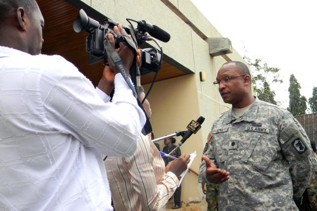 Lt. Col. Rodney Boyd, officer-in-charge of the U.S. MEDFLAG 11 forces and the commander of the 405th Brigade Support Battalion, a National Guard unit from Chicago, Ill. , speaks to Ghanaian media following the exercise opening ceremony July 11 in Accra.