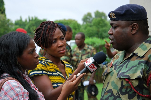 Lt. Col. (Dr.) Gordon Appiah, a neurosurgeon with the Ghana Armed Forces 37th Military Hospital, speaks to local television station reporters following the MEDFLAG 11 opening ceremony July 11 in Accra.