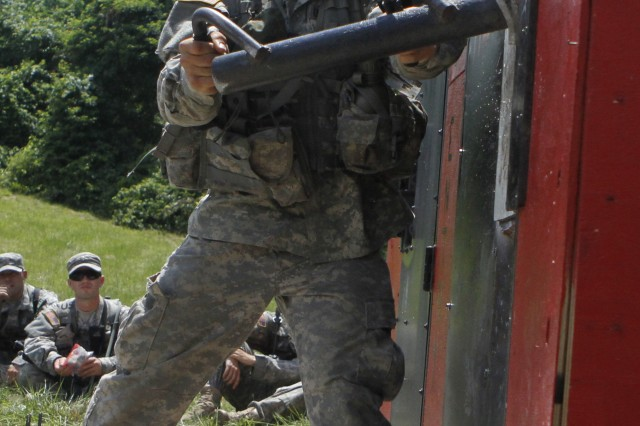 West Point Class of 2014 Cadet Ian Morris team attempts a door breach July 14 during Cadet Field Training. Soldiers attached to Alpha Company, 2BSTB, 10th Mountain Division (LI), provided their expertise in combat engineering to 6th Company on July 13 during Cadet Field Training. Photo by Mike Strasser, West Point Public Affairs