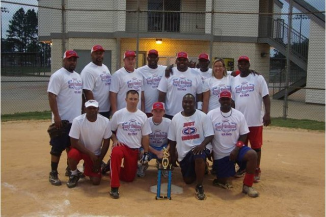 "The 2011 Third Infantry Division's championship softball team from Hunter Army Airfield ""Just Enough"" poses for a team photo. The Hunter champions defeated Fort Stewart's 526th Eng. Co. 21-4 in the championship game at Fort Stewart, July 6."