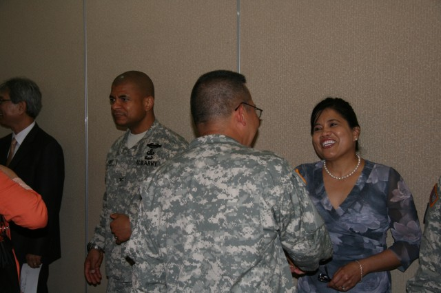 New 403rd Army Field Support Brigade Commander Col. Michael Lopez and his wife, Marianne, greet guests during a reception following the change of command. The ceremony and reception took place July 8 on Camp Walker, Daegu, Korea.