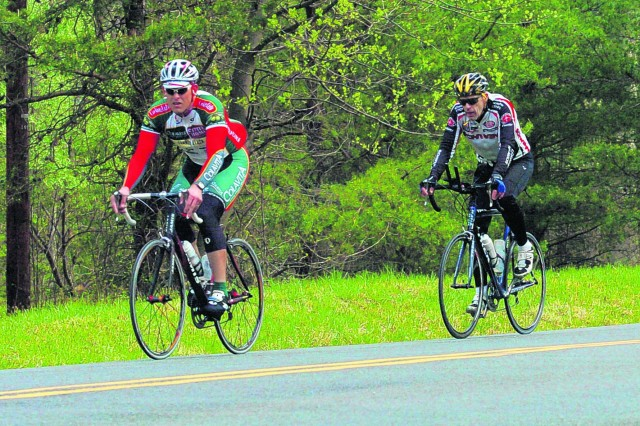 Cyclists along Gunston Road wear colorful and protective clothing.