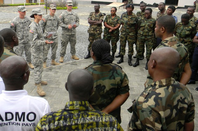 Spc. Kerry Thompson, a medic from the 814th Medical Detachment of the North Dakota Army National Guard and a native of Bismarck, N.D., instructs Soldiers from the Ghanaian army on the steps of triage before a practice exercise July 14, 2011, at Burma Camp, Accra, Ghana during MEDFLAG 11.