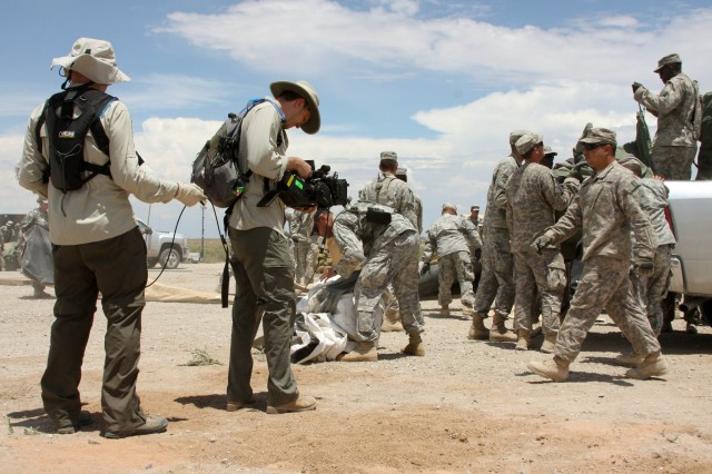 "KPI productions joins 2nd Brigade, 1st Armored Division for a few days during their Network Integration Exercise at White Sands Missile Range, N.M., July 14, 2011. The goal of the production crew was to get footage and interviews for use in the creation of a pilot episode of ""Battle Lab."""
