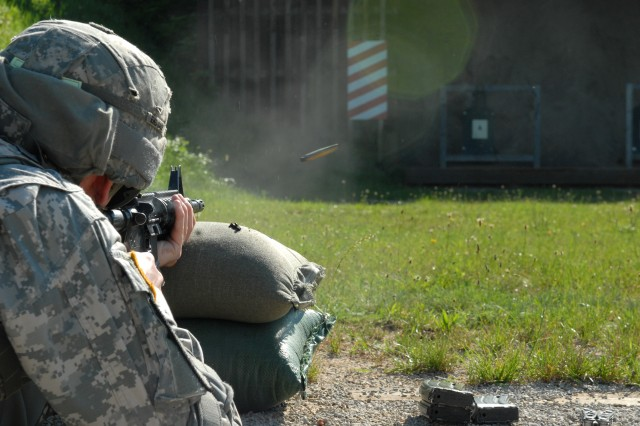 Sgt. Timothy Dingle, a chemical operations specialist with the 12th Chemical Company, 18th Combat Sustainment Support Battalion, 16th Sust. Brigade, 21st Theater Sust. Command, fires his rifle during the qualification range portion of the 16th Sust. Bde. Warrior and Warrior Leader of the Quarter competition on Warner Barracks, Bamberg, Germany June 28. Dingle won the title of Warrior Leader of the Quarter and will go on to compete in the 16th Sust. Bde. Warrior of the Year competition next year.