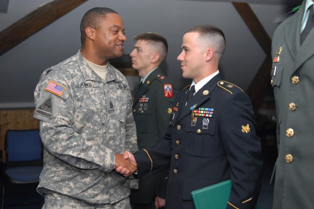 Command Sgt. Maj. Walton Jones, the 39th Transportation Battalion command sergeant major, congratulates Spc. Steven Palmer, a motor transport operator with the 66th Trans. Company, 39th Trans. Bn., 16th Sustainment Brigade, 21st Theater Sust. Command for winning the title of Warrior of the Quarter during the 16th Sust. Bde. Warrior and Warrior Leader of the Quarter competition on Warner Barracks, Bamberg, Germany June 28-30.