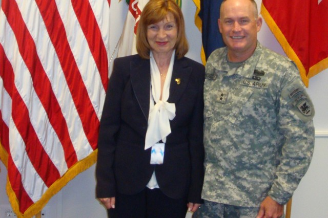 Vera Frater (left) and U.S. Army Africa Commander, Maj. Gen. David R. Hogg, pose for a photo in the USARAF command building on Caserma Ederle in Vicenza, Italy.