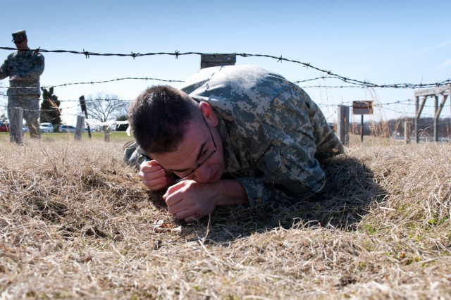 Spc. Bernard Quackenbush negotiates a concertina wire obstacle during the RDECOM Soldier of the Year competition in April 2011.