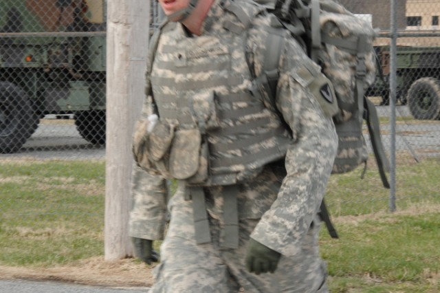 Spc. Bernard Quackenbush nears the end of a 12-mile road march during the RDECOM Soldier of the Year competition in April 2011.