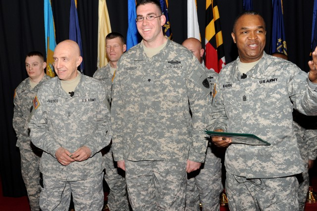 Spc. Bernard Quackenbush is congratulated by Maj. Gen. Nick Justice, left, and Command Sgt. Maj. Hector Marin after winning the RDECOM Soldier of the Year competition in April 2011.
