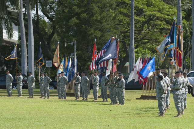 """Brig. Gen. Jeffery Underhill, commander of 94th Army Air and Missile Defense Command hosted a Flying """"V"""" ceremony to honor and welcome Brig. Gen. Robert F. Mathews, U.S. Army Pacific deputy commanding general, July 18 at Palm Circle, Fort Shafter, Hawaii. The Flying """"V"""" refers to the way commanders and colors are posted during the ceremony which is in a V-shaped formation."""