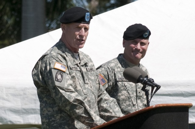 """Brig. Gen. Robert F. Mathews, USARPAC deputy commanding general (left), addresses the formation.  Mathews was honored with a Flying """"V"""" ceremony hosted by Brig. Gen. Jeffery Underhill, commander of 94th Army Air and Missile Defense Command."""