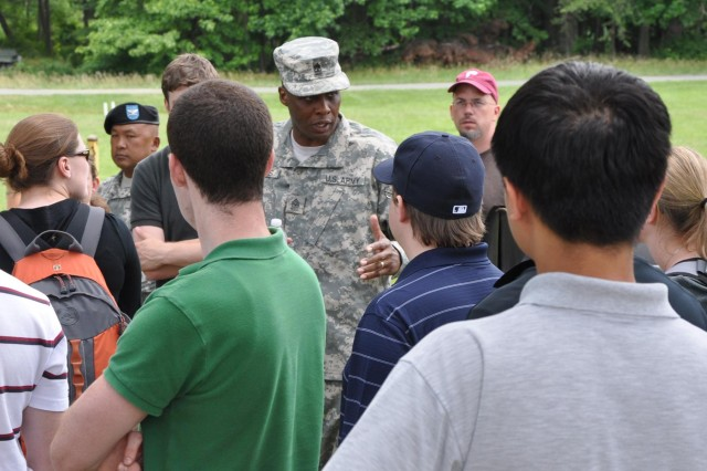 Sgt. Maj. Christopher Harris leads a discussion on how military training  meets real-world combat situations.