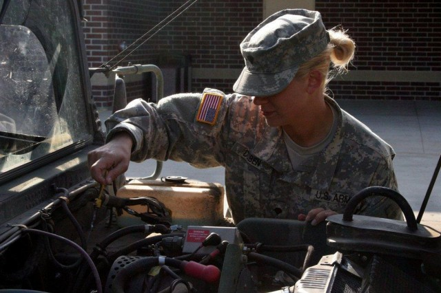 Spc. Kathryn Duben, with Battery C, 1st Battalion, 188th Air Defense Artillery Regiment, performs a maintenance check on her vehicle while assigned to quick response force in Mandan, N.D., July 16, 2011. Approximately 350 Guardsmen remain on state active duty in the central North Dakota flood fight.