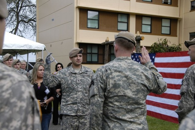 Sgt. 1st Class Leroy A. Petry takes the oath of enlistment administered by Maj. Rob Shaw on April 22, 2010 at Fort Lewis, Wash.