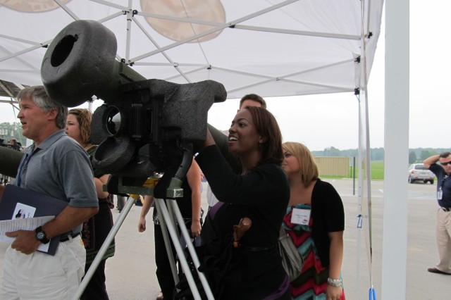 WHNT-19 anchor Clarissa Stephens looks through a Javelin launcher at Test Area 1. Stephens said she wanted to learn more about what Redstone does and what technology exists on the Arsenal and in Huntsville.