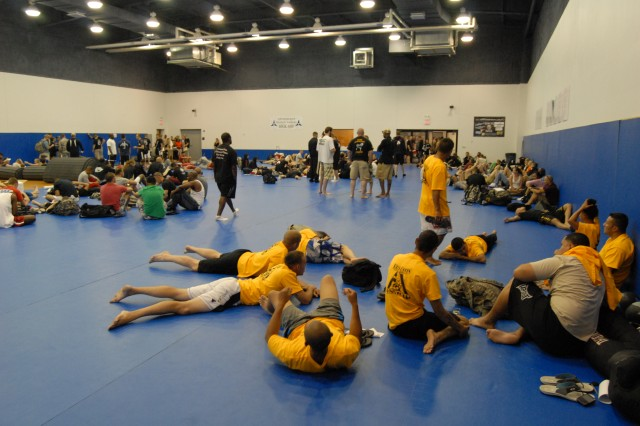 Competitors relax after registering for the 2011 U.S. Army Combatives Championship inside the Kieschnick Physical Fitness Center at Fort Hood, Texas July 20, 2011.