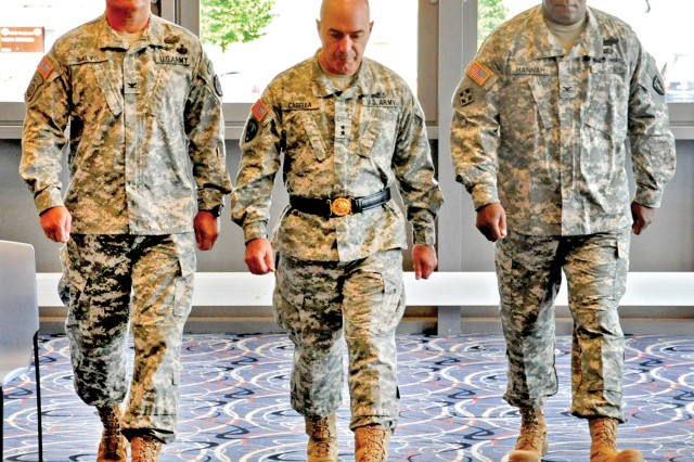 Col. Chuck Salvo (from left), Maj. Gen. Bruce A. Casella and Col. Fredrick J. Hannah arrive at the Wiesbaden Entertainment Center for the Army and Air Force Exchange Service-Europe change of command ceremony.