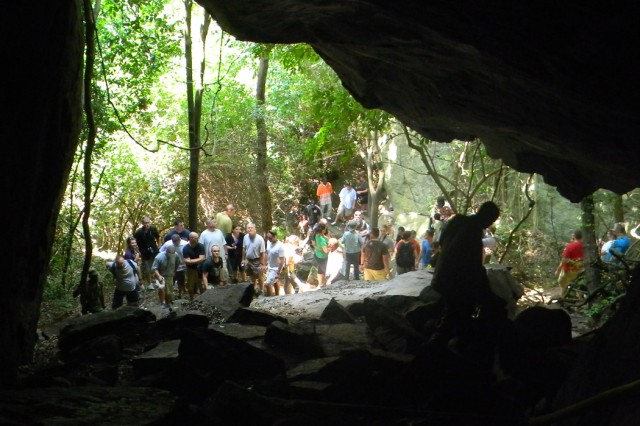 U.S. Soldiers participating in MEDFLAG 11 climb and tour the Shai people's ancestral cave during a July 17 visit to the Dodowa area of Ghana.