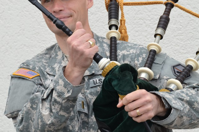 Second Lt. Pascal Reber, Executive Officer of Company B, 24th Millitary Intelligence Battalion located on Patton Barracks in Heidelberg adjusts the pipes before playing his bagpipe during his break. Reber  will head to Glasgow, Scotland, in August to compete in the World Pipe Band Championships.
