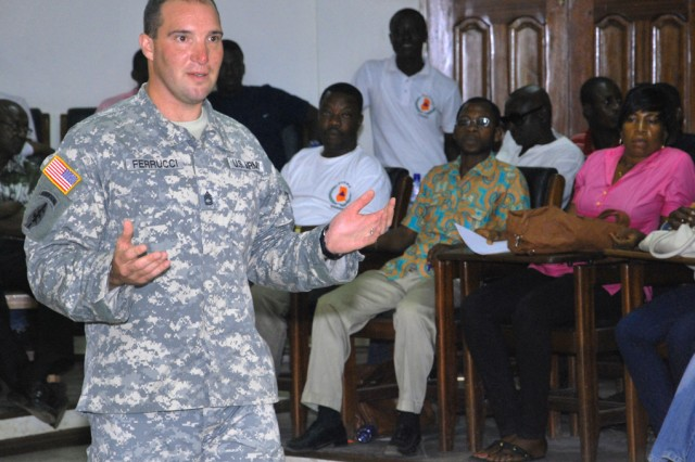 Sgt. 1st Class Samuel Ferrucci, a combat medic with the 411th Civil Affairs Battalion, trains about 70 volunteers from Ghana's National Disaster Management Organization on how to recognize and treat the three degrees of burns July 15, 2011, at the Tema Metropolitan Assembly building in Ghana.