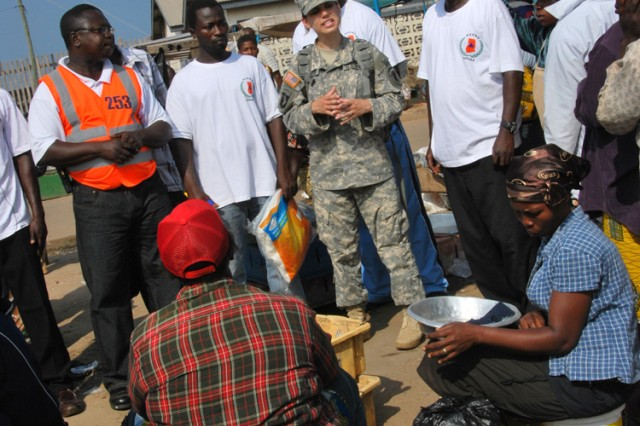 With help from the National Disaster Management Organization, Sgt. Bethany Seymour, a civil affairs sergeant from the Army Reserve's 411th Civil Affairs Battalion, educates the public about malaria prevention at the harbor of Tema, Ghana, July 15, 2011.