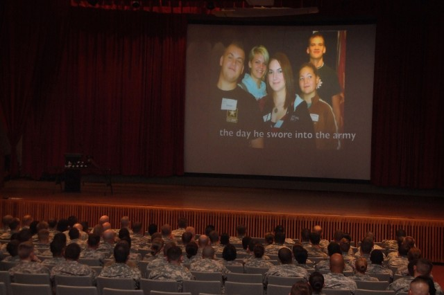 FORT CARSON, Colo. -- Soldiers from 4th Infantry Division watch a slideshow presentation in McMahon Auditorium July 15, which highlighted the life of Spc. Kale Clay, 3rd Battalion, 16th Field Artillery Regiment, 2nd Brigade Combat Team, 4th Infantry Division, which ended on Highway 115, near Fort Carson.