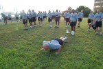 Charleston Company 1st Sgt. leads PT training by example.