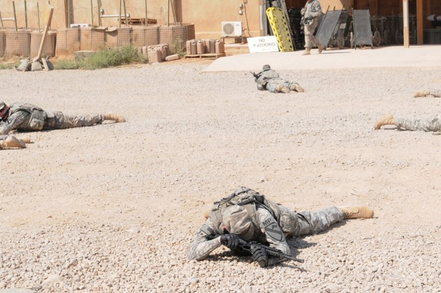 "Soldiers participating in the combat lifesaver course react to simulated indirect fire before caring for ""casualties"" during training at the Teal Medical Clinic at Contingency Operating Base Warhorse, Iraq, July 13, 2011."