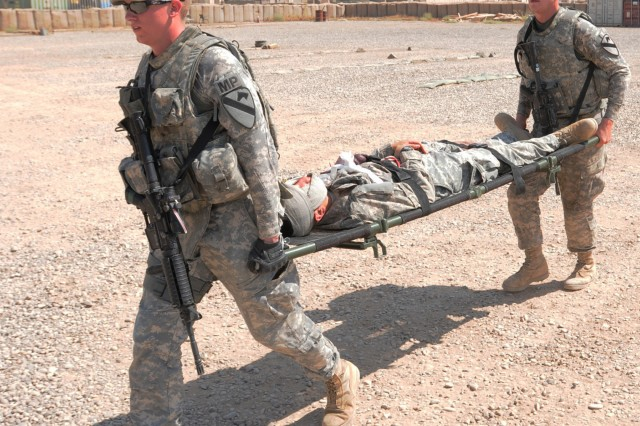 Soldiers from 2nd Advise and Assist Brigade, 1st Cavalry Division, carry a Soldier with simulated third-degree burns to a landing zone during combat lifesaver training at the Teal Medical Clinic on Contingency Operating Base Warhorse, Iraq, July 13, 2011. More than 25 Soldiers completed the four-day combat lifesaver course.