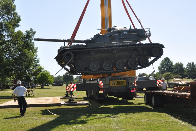 "Riggers maneuver an AN/MLQ-34 ""TACJAM"" Countermeasure Set being offloaded at the APG Museum. The museum, slated to open in October 2012, took possession of 11 large artifacts donated from the Army museum at Fort Monmouth, N.J., July 14."