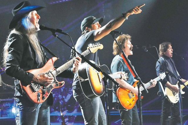 (From left) Patrick Simmonds of the Doobie Brothers performs with Country star Luke Bryan and Doobie Brothers Tom Johnson and John McFee during a taping for an episode of CMT Crossroads in June. The famous group brings its act to APG in the Army Concert Tour featuring Lynyrd Skynyrd and Dilana Aug. 20. Visit www.apgmwr.com for more information.