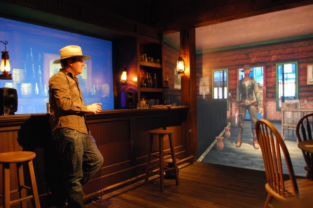"Jameson Moore, a computer scientist with the Institute for Creative Technologies, converses with a character in the mixed-reality Gunslinger program—an interactive-entertainment application of virtual humans, which transforms an iconic ""wild west"" movie scene into a vivid semblance of reality."