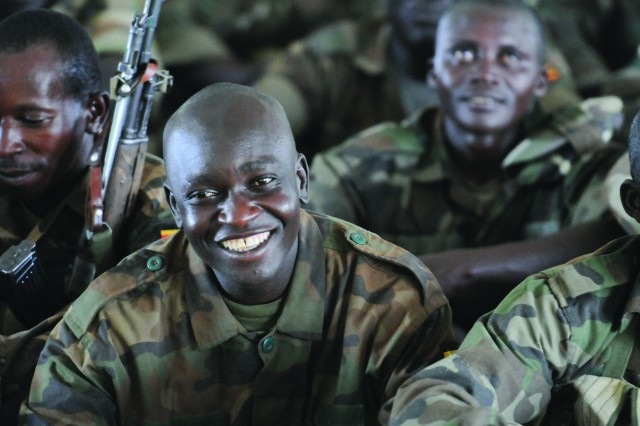 A Uganda Peoples Defense Force soldier smiles during a light moment in training at DZ Red near Kapelebyong during Atlas Drop 11, April 14.