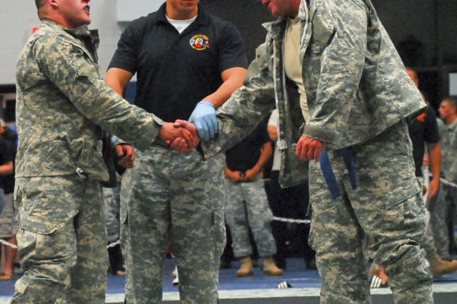 Specialist Christopher Rosado (left), 1-508th PIR, 101st Abn. Div., from Fort Campbell, Ky., shakes hands with Sgt. Bradens Simont, Minnesota National Guard, following their match at the 2011 U.S. Army Combatives Championship July 22 at Fort Hood, Texas. Simont won the match. (U.S. Army photo by Spc. Nathan Booth, 4th Public Affairs Detachment)