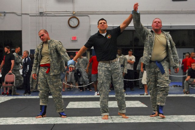 Sergeant Bradens Simont, Minnesota National Guard, is declared the winner in his bout against Spc. Christopher Rosado, 1-508th PIR, 101st Abn. Div., Fort Campbell, Ky., during the second day of action at the 2011 U.S. Army Combatives Championship July 22 at Fort Hood, Texas. (U.S. Army photo by Spc. Nathan Booth, 4th Public Affairs Detachment)