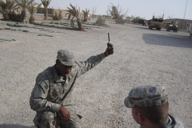 Spc. Nicholas Matthews, a radio technician with the 941st Transportation Company, 749th Combat Sustainment Support Battalion, 4th Sustainment Brigade, 310th Expeditionary Sustainment Command, and a Charleston, S.C., native, waits for a signal to come in on the radio at Contingency Operating Base Adder, Iraq, July 11. (U.S Army photo by Spc. Crystal Williams)