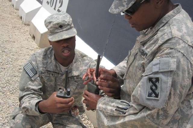Spc. Nicholas Matthews, a radio technician, and Sgt. Donia Manigualt, a radio dispatcher, both from Charleston, S.C., and with the 941st Transportation Company, 749th Combat Sustainment Support Battalion, 4th Sustainment Brigade, 310th Expeditionary Sustainment Command, test radios at Contingency Operating Base Adder, Iraq, July 11. (U.S Army photo by Spc. Crystal Williams)