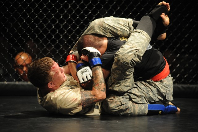 Staff Sgt. Benjamin Westrich, Fort Carson, Colo., throws a punch to the head of 2nd Lt. Nathan Gelinas, Maneuver Center of Excellence, Fort Benning, Ga., in a consolation bout July 23, at Fort Hood, Texas. Westrich defeated Gelinas in a split decision to win third place in the lightwieght division at the 2011 U.S. Army Combatives Championship.