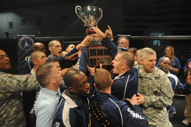 The III Corps team celebrates their second straight team title at the U.S. Army Combatives Championship at Fort Hood, Texas, July 23, 2011.