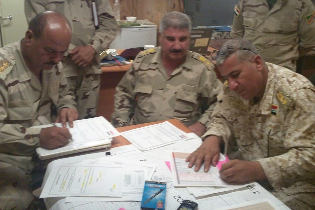 "Iraqi Army Officers assigned to 10th Brigade, 3rd IA Division, sign paperwork to transfer authority of Contingency Operating Site Sykes from U.S. to Iraqi responsibility during a meeting at the base, July 13, 2011. ""This is the largest base so far that we have transitioned since arriving in country,"" said Lt. Col Paul Reese, deputy commanding officer assigned to 4th Advise and Assist Brigade, 1st Cavalry Division."