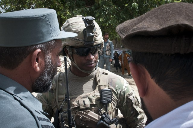1st Lt. Michael L. Graddy, an infantry platoon leader assigned to Troop C, 3rd Squadron, 4th Cavalry Regiment, Task Force Raider, 3rd Brigade Combat Team, 25th Infantry Division, Task Force Bronco, discusses strategy with Afghan Uniformed Police, or AUP, chief, Col. Anam Shaw, left, before assisting in a clearing operation in Kot district, Nangarhar province, eastern Afghanistan, July 19, 2011. Graddy and his Soldiers helped in the joint operation that cleared a suspected insurgent hideout with help from two different AUP districts, the district sub governor and the Afghan district attorney.