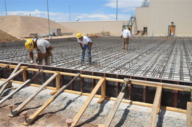 Workers install rebar for the clean dunnage staging area foundation, which is located west of the Enhanced Reconfiguration Building.