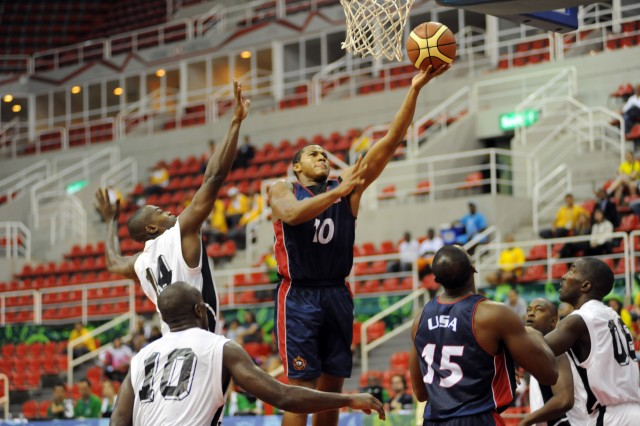 U.S. Army 2nd Lt. Cleveland Richard of Fort Lee, Va., drives for two of his 10 points during Team USA's 74-54 victory over Trinidad and Tobago at the 5th Counseil International du Sport Militaire Military World Games in Rio de Janeiro. Team USA suffered its first loss of the tournament Saturday to Brazil, but won a bronze medal against South Korea on Sunday. Host Brazil and Greece will play for the gold and silver.