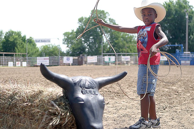 Mylique Haseman, who will be a first-grader at Chapman Elementary this fall, practices roping a bull during the Exceptional Family Member Program Special Needs Rodeo July 16, 2011, at the Geary County Fairgrounds, Junction City, Kan.