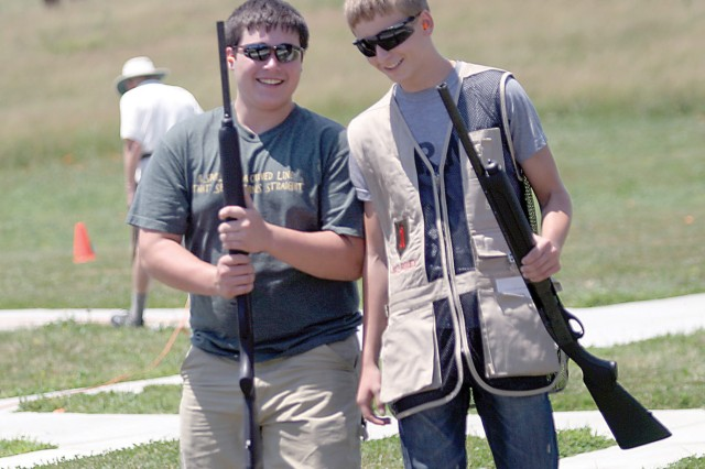 Two boys who participated in the second annual Fort Riley Youth Skeet camp laugh after participating in one of the skeet competitions at the end of camp June 30 at the Fort Riley Skeet and Trap Range, Fort Riley, Kan.