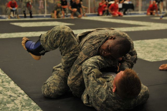 Spc. Brian L. Wilson (top), Company G, 203rd Forward Support Company, 3rd Infantry Division, fights hard for dominance during a match in the 2011 All-Army Combatives Tournament Semi-Finals July 22, 2011, held at Fort Hood, Texas.