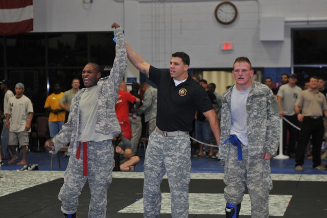 Spc. Brian L. Wilson (left), Company G, 203rd Forward Support Company, 3rd Infantry Division, yells in excitement as he wins a match in the 2011 All-Army Combatives Tournament semi-final round, advancing him to the finals, July 22, 2011, at Fort Hood, Texas.