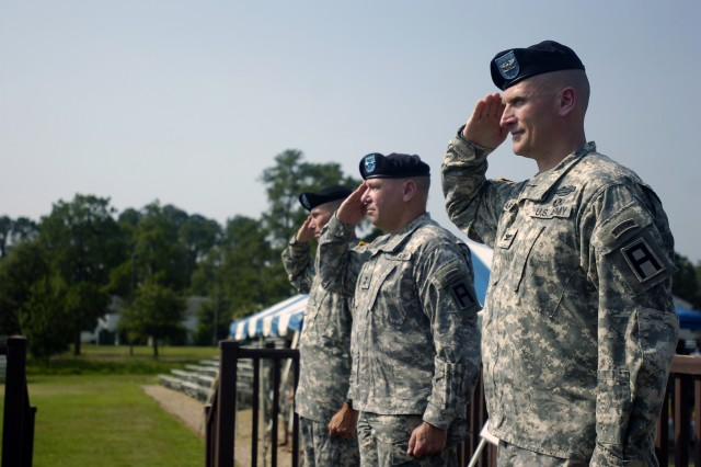 Col. Stephen Quinn, Maj. Gen. Kevin R. Wendel, and Col. John Marr return a salute to the Soldiers of the 189th Infantry Brigade during the brigade's change of command and casing of the colors July 20 at Fort Bragg, N.C.