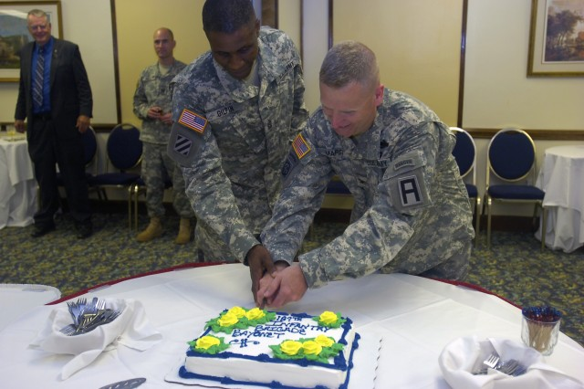 Col. John Marr, commander of the 189th Infantry Brigade, and Command Sgt. Maj. Christopher Gilpin, the brigade's top enlisted Soldier, cut a cake commemorating the unit's change of command and casing of its colors at a reception hosted by Marr July 20 at Fort Bragg's Officer's Club.